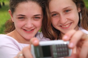 Teens connect via technology, a student recruitment opportunity.
