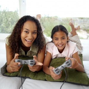 Mother and Daughter Playing Video Games --- Image by © Royalty-Free/Corbis